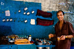 A sip of life? (Catch the dream) Tags: people smile bottles tea cups dhaka streetfood bangladesh cupoftea sip kettles paintedwall olddhaka countrypeople teastall teavendor streetshops cupoflife shakharibazar streetteastall