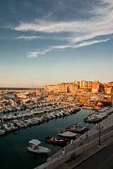 la luce del tramonto sul porto (ROSSANA76 Getty Images Contributor) Tags: panorama italia tramonto nuvole mare barche porto cielo acqua turismo pesca puglia luce bari sud sera bisceglie meridione