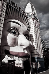 Evil Clown (Darius Darkly) Tags: park city urban building clouds point outdoors crazy nikon moody shadows harbour clown low sydney australia saturation lunapark desaturated nikkor iconic sydneyharbour milsons funpark milsonspoint shadowed 18105mm