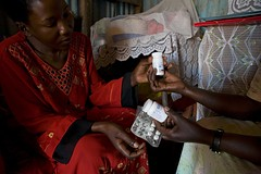 Alice Nabakooze (HIV/AIDS KMCC Uganda) Tags: woman listening pills medication discussing arvs