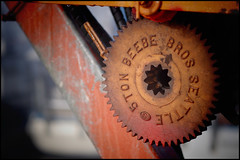 """Beebe Bros. Seattle"" (Eric Flexyourhead) Tags: red canada detail port dock rust bc bokeh harbour crane britishcolumbia rusty gear richmond wharf rusting winch 45mm steveston patina fragment zd beebebros olympusep1 mzuikodigital45mmf18"