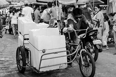 Cold work (RM Ampongan) Tags: street city white 3 black cold ice wet bike bicycle photography big place candid philippines wheels transport shades goods only push sur block chunk bicol maket camarines iriga yelo padyak