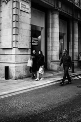 Ordinary situations (Marc Nikonis) Tags: street city england people white man black london english women noir fuji leute gente strasse femme stadt londres gb angleterre fujifilm ingles frau rue weiss blanc personnes schwarz ville homme gens inglese passant inghilterra anglais individus fussgaenger