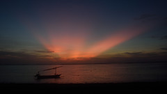 Sunrise at Sanur beach (StwenBoy) Tags: ocean sea sky bali cloud seascape beach water silhouette sunrise dawn boat outdoor indianocean shore crepuscular sanur balisea sanurbeach