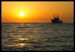 (Patri Morales Photography) Tags: sunset sea sky sun mer sol water atardecer boat mar spain agua corua barco ship galicia amarillo cielo reflejo puestadesol naranja olas horizonte morales patri