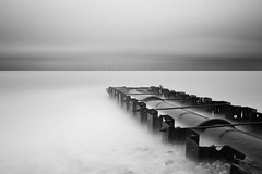 Pipeline (Anthony Owen-Jones) Tags: ocean uk longexposure sea sky blackandwhite bw cloud white mist seascape black beach water monochrome lines wales clouds canon lens landscape eos rebel mono coast landscapes photo seaside kiss europe long exposure moody unitedkingdom horizon north perspective picture minimal filter photograph ethereal nd kit milky rhyl minimalist bnw conwy t3i x5 northwales abergele 600d pensarn takenwith 10stop nd110 canonefs1855mmf3556is rebelt3i kissx5