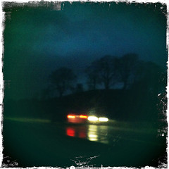 Traffic_2 (soilse) Tags: road trees cars silhouette evening town silhouettes bluesky headlights squareformat a5 carlights darkclouds redlights darksky mainroad iphone tyrone newtownstewart carsatnight cotyrone iphonecamera townlights carsinthenight a5road hipstamatic dublintoderryroad dublinderryroad