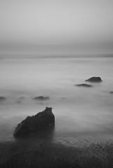 Feel (W Mustafeez) Tags: ocean california bw seascape beach nature beautiful misty digital landscape photography nikon san francisco rocks long exposure peace 10 calm stop serenity nd rodeo 1635mm d700