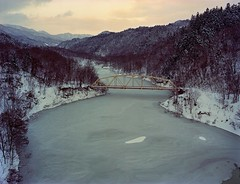 Closing flow (threepinner) Tags: bridge winter lake mamiya ice japan river flow iso100 evening hokkaido north negative 55mm     hokkaidou 1000s mikasa  selfdevelopment northernjapan sekor m645  katsurazawa  gettyimagesjapanq4 ektyar