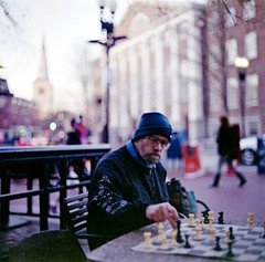 Chess Master (Dr. RawheaD) Tags: one dof kodak chess 66 stop harvardsquare push f2 portra 800 80mm norita noritar