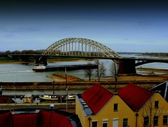 The Nijmegen Bridge, Netherlands (Explored) (Butch Osborne) Tags: travel bridge holland netherlands nijmegen wwii historic worldwarii combat 1001nights barge rhineriver operationmarketgarden 82ndairbornedivision 1001nightsmagiccity
