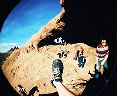 Foot shot 2011 - Papago Park (kevin dooley) Tags: park orange film phoenix rock analog 35mm lens foot shoe lomo lomography shot angle side hill leg wide photographic fisheye plastic sp papago analogue tradition extra kd phx tennisshoe shoelaces footshot nosocks fisheye2 valleyofthesun shoeshot gymshoe andydooley