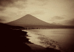 Amed, Bali (EdBob) Tags: ocean sea sky blackandwhite bw bali mountain texture beach sepia clouds indonesia blacksand volcano fishing village indianocean wave gunung agung amed blacksandbeach gunungagung jukung eastbali mtagung iphotoedited edmundlowe edlowe edmundlowe allmyphotographsarecopyrightedandallrightsreservednoneofthesephotosmaybereproducedandorusedinanyformofpublicationprintortheinternetwithoutmywrittenpermission edmundlowephotography edmundlowestudiosinc