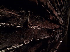 Brickwork Detail (1) (mark-vauxhall) Tags: bricks brickwork brick mortar bar cambridge ma massachusetts 02139 mass ave avenue shadows lighting light dim low dark detail closeup cameraphone phone mobile cell
