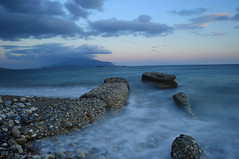 Blue & Sea! (Manos Eleftheroglou (Photography)) Tags: longexposure blue winter light sunset sea sky seascape cold colour film beach nature water ecology beautiful clouds island greek nikon europe exposure waves niceshot sundown natural aegean scenic hellas tranquility natura scene east greece griechenland soe wetland samos 2012 ecological waterscape autofocus pythagorion pythagorio aegeansea blueribbonwinner supershot  abigfave   d5000  potokaki    flickraward  theunforgettablepictures betterthangood goldstaraward   nikonflickraward nikond5000 bestcapturesaoi tripleniceshot ringexcellence blinkagain dblringexcellence makisamos tplringexcellence  bestofblinkwinners