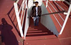 dark man (cHr1st1an S images) Tags: city light boy shadow portrait people italy sunlight man color film colors lines analog lomo lomography flickr ship sardina shadows stairway negative genova staircase analogue analogic colorfilm analogico negativefilm lasardina chr1st1ans christiansorrentino
