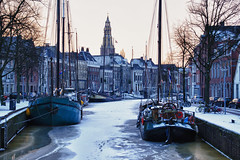 An early winter morning in Groningen (Explore) (Bert Kaufmann) Tags: city winter holland ice netherlands dawn early ship bevroren ships nederland explore stadt groningen eis paysbas morgen hdr stad olanda ochtend reitdiep niederlande ijs schip schepen vroeg morgenrood explored stadsbeeld lagedera hogedera