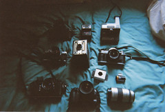(emilyharriet) Tags: blue black film digital canon lens polaroid eos pentax k1000 ae1 olympus om10 cameras stuff zenit disposable 100d