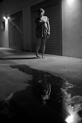 i'll lead you there (thewhitestdogalive) Tags: street portrait blur reflection water girl beauty night fun bokeh barefoot outfocused riccardobandieraphotography riccardobandieracom