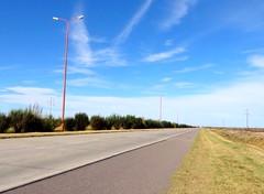 Cordoba, Argentina (Benjamn Vial) Tags: street blue red lamp argentina grass clouds way cordoba infinite longway
