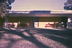 Adams Elementary (rileymillion) Tags: school windows shadow building architecture bench concrete doors 35mmfilm disposablecamera analogphotography lateafternoon breezeway adamselementary colorfilm color35mm