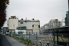 Morning of the cloudy day (yasu19_67) Tags: morning cloud film japan fence 50mm graffiti alley kodak railway osaka olympusom1 hankyu photooftheday filmphotography gold200 zuiko50mmf18 filmism