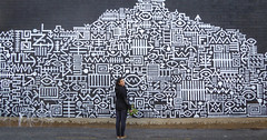 Annabel in Symbol City (Theen ...) Tags: city brick art wall project lumix blackwhite mural symbol human figure adelaide annabel theen kenttown littlerundlestreet