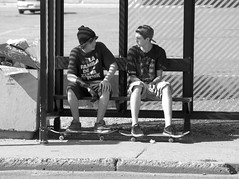 Skate Board Buddies (Shotbox) Tags: street bw white lake black minnesota st noiretblanc streetphotography minneapolis olympus skateboard e1 lakestreet skateboarder