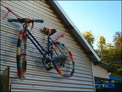 A Hallmark Of Any Sustainable Home (suavehouse113) Tags: bike bicycle festival community suburban decoration australia fair decor fremantle openhouse freo westernaustralia sustainability philscamera artsandcrafts 2011 southfremantle guerrillaknitting hulbertstreet yarnbombing hulbertstreetsustainabilityfiesta