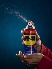 Multipurpose Magical Product - WD-40 (Captain Suresh Sharma) Tags: blackbackground flashphotography productphotography indoorphotography redcolour industrialproduct canon50d captsureshsharma industrialspray canonphotographygear industrialbottle usefulproductfordoemsticuse