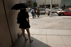 Daytime landscape view of a woman standing in the shade with an open umbrella in the Ginza district (Infradept) Tags: poverty holiday tourism weather japan retail landscape earthquake energy commerce realestate employment accident evacuation destruction conservation tsunami disaster infrastructure environment commuting 311 renovation tohoku commonwealth crisis recovery nuclearpower unemployment ecosystem demographics rebuilding dwelling consumers renewableenergy publicrelations homelessness recession nuclearenergy foreignaid privatisation massmedia naturalresources naturaldisasters energysaving environmentalpollution lifeexpectancy grossdomesticproduct consumerconfidence humandevelopmentindex economicgrowth labourmarket foodindustry disposableincome emergingmarket nationalisation lifestyleandleisure housingandurbanplanning postcrisis luxurygood landprice freighttraffic wastemanagementandpollutioncontrol post311 markettrend commoditymarket urbanlivingconditions domestictrade householdconsumption talkaboutjapan frivilousconstruction layoffsanddownsizing nondurablegood percapitaenergyconsumption structuralfailures