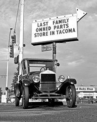 Last holdout () Tags: world auto street old family usa history classic cars sign america corner vintage photo store automobile image parts united picture automotive neighborhood nostalgia photograph independent american owned round lincoln nostalgic americana headlight arrow local states collectors collector 56th worldcars