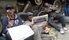 Tired Protesters Resting Under A Tank Near the Egyptian Museum off Tahrir Square. (alisdare1) Tags: sleeping tank 10 newspapers tired resting february protesters tahrir 2011