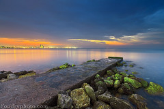 2011 Last Sunset (A.alFoudry) Tags: xnuzha foudryphotocom abdullah alfoudry abdullahalfoudry kuwait kuwaiti kuw q8 q8city q80 canon eos 5d || 5d|| canoneos5d|| mark|| mk|| mark mark2 canoneos5dmark|| full frame fullframe ef 1635mm f28l canonef1635mmf28lmark|| bech sea shore low tide lowtide sun 2011 arab gulf line rock rocks blue orange green seaweed clouds cloud dusk mirror bridge sunset slow shutter slowshutter leefilter lee filter الفودري الكويت