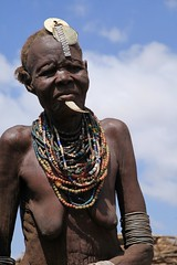 Dassanech Daasanach Tribe. Lower Omo River Valley. South West Ethiopia. (eriagn) Tags: africa travel portrait woman man usaid girl face proud river beads breasts child culture jewelry tribal sediment blackpeople omovalley bangle tradition ethiopia tribe ethnic wrinkles arid silt adornment bottlecaps hornofafrica ethnology wfp dirtywater headrest canoncamera subsistence galeb omorate omoriver agedwoman dassanech africaportrait seminomadic daasanach dasenach southwestethiopia eriagn ngairelawson pillowseat carvedpirogue treetrunkboat agripastural