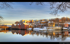 Winter at Bakklandet - Trondheim - Norway (vegarste) Tags: bridge trees houses winter sunset snow reflection water norway river norge vinter nikon europe branches norwegen warehouse getty bro scandinavia trondheim hdr hus warehouses vann gettyimages snø nidelva bru bakklandet brygge refleksjon trær trøndelag d90 3xp photomatix gamlebybro tonemapping brygger 3exp grener