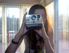 the magic is lost. (allison.johnston) Tags: camera light self polaroid wrist landcamera odc onstep ourdailychallenge