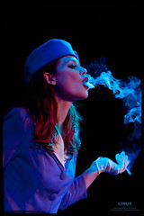 Particulate (Linus Gelber) Tags: show nyc woman newyork girl brooklyn cigarette smoke performance smoking gowanus smoker stewardess burlesque boerumhill bellhouse flightattendant justinejoli canon28135mmisusm girlsinuniform wasabasscoburlesque