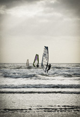 Windsurfers In a line (GarethThomasJones) Tags: camera uk white black photoshop canon photography landscapes jones ixus pro pointandshoot gareth gtj compact 2012 lightroom garethjones 100is sd780 canonsd780 lightroom4 garethjonesphotographyportsmouth garethjonesportsmouth gareththomasjones