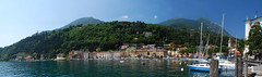 Boats moored at a harbor, Lake Garda, Gardone Riviera, Italy (Jeka World Photography) Tags: world city travel sea italy cloud mountain lake reflection beach jeff nature rose rock horizontal architecture sailboat outdoors photography harbor town europe day sailing cityscape waterfront hill nopeople panoramic transportation lakeshore coastline rockymountains rippled vacations trentino scenics clearsky lakegarda inarow mountainrange tranquilscene jeka moored rivadelgarda traveldestinations colorimage famousplace mountainpeak locallandmark jeffrose modeoftransport buildingexterior highangleview mediterraneanculture italianculture builtstructure nauticalvessel jekaworldphotography jeffrosephotography kalitharosephotography