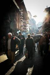 marketPlace (bass_nroll) Tags: winter light people sun work canon shopping ray market faith istanbul human trading rays luce bazar turkish controluce raggi eminn quartiere contro 450d