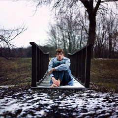 Forlorn (Cameron Bushong) Tags: bridge blue trees snow man cold shirt self square bokeh jeans bracelet 366 stupidgeese
