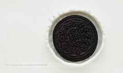 OREO (disgruntledbaker1) Tags: white black macro nikon cookie space flash negative half 60mm oreo splash monday f8 bounced d90 sb400 disgruntledbaker1 uploaded:by=flickrmobile flickriosapp:filter=nofilter