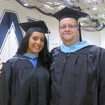 Graduates posing at graduation