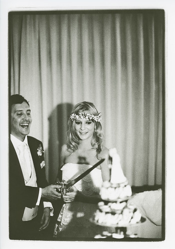 Example of obligatory wedding album photo - Bride and groom cutting cake