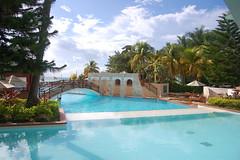 (John Donges) Tags: jamaica caribbean ocean water island resort vacation tropical negril pool blue bridge palm trees hotel 3868
