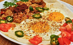 Mmm... Huevos rancheros with Spanish rice and braised pork (jeffreyw) Tags: tomatoes eggs mole tortilla jalapenos spanishrice huevosrancheros braisedpork