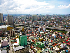 Aerial Shot of Makati and Manila City (GreenArcher04) Tags: world city sky urban house building eye birds skyline modern clouds skyscraper canon river bay construction asia cityscape view metro south philippines aerial powershot east manila cebu third housing shanty boracay makati residential condominium flyover davao quezon s90 palawan roxas squatter pasig marikina mandaluyong slex