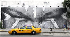 NYC Taxi (Dreamer7112) Tags: nyc newyorkcity ny newyork ads advertising nikon manhattan cab taxi ad streetphotography yellowcab jr advertisement bowery houstonstreet cabs advertisements d300 acrossthestreet nyctaxi uniqlo nikond300 bowerymural boweryhoustonwall yellwocabs