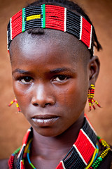 portrait of a little girl the tribe benna, omo valley, ethiopia (anthony pappone photography) Tags: africa travel portrait baby color colors face barn digital canon pose photography photo eyes colorful colours colore foto faces image expression retrato african picture culture portraiture afrika omovalley fotografia ethiopia tribe ritratto reportage photograher afrique barna bambina faccia omo phototravel etiopia etnic  etnico ethiopie etiope etnia  etnica etnologia benna afryka childrentravel keyafer etiopija portraitsofchildren  etiopien etipia africantribe  etiopi eos5dmarkii  omotribe tribebenna